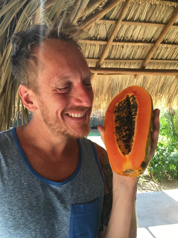 Chef Aram holding a papaya