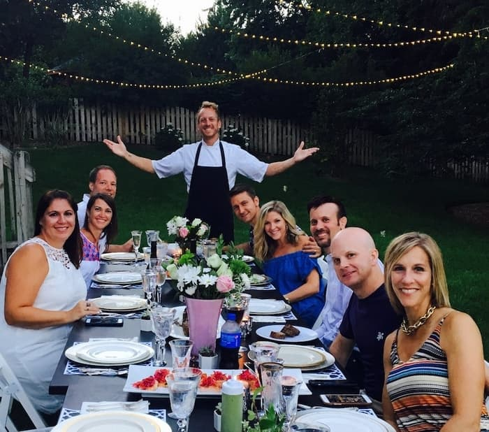 chef aram standing in front of table of guests