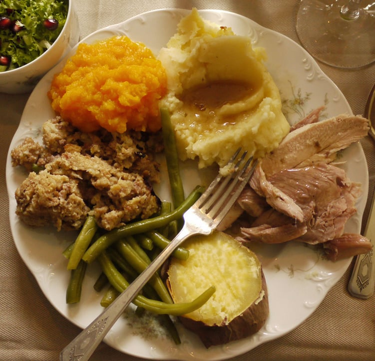 thanksgiving dinner with turkey beans potatoes and stuffing